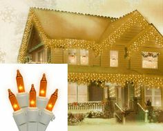 "$9.99-$16.99 Set of 100 Amber Mini Icicle Christmas Lights - White Wire - Set of 100 Mini Icicle Christmas Lights  Item #W4W4111  Features: Color: amber bulbs / white wire  Number of bulbs on string: 100 Bulb size: mini  Drop lengths approximately alternate between 11""L, 15""L, 18""L, and 21""L Spacing between each bulb: 3.5 inches  Spacing between each drop: 4 inches  Approximate lighted string le ..."