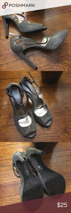 Amazing worn 1 time heels!!! These heels are a great black gold! They have a 4.5 in heel, and a great double strap! I have worn only 1 time!! Shoes Heels