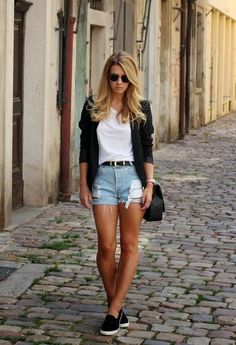 make denim shorts more dressed up with black slip-on sneakers and a blazer.