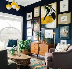 indigo blue walls, dark walls with gallery and mid century modern media console