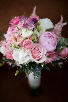 Bridal bouquet with peonies, roses, hydrangea,astrantia, astilbe and eucalyptus. Designed by Forget-Me-Not Flowers Banff. Photo by Julie Williams photography. http://www.juliewilliamsphotography.ca/