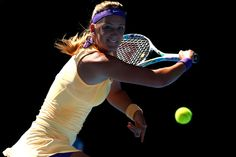 Victoria Azarenka of Belarus plays a backhand in her Semifinal match against Sloane Stephens of the United States during day eleven of the 2013 Australian Open at Melbourne Park on January 24, 2013 in Melbourne, Australia.