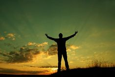 Photo about A man makes his morning prayer, holding his arms up to the sun. Image of hill, raised, prayer - 8454229