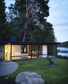 black, transparant architecture in a green setting