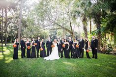 Outdoor Bridal Party Wedding Portrait with Black Bridesmaids Gowns and White, Strapless Wedding Dress with Orange and Gold Rose Bouquets | Downtown Tampa Wedding Photographer Limelight Photography
