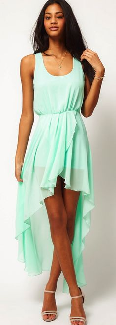 i love how these dresses go longer in the back it is so cool.