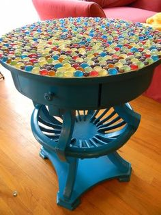 This is a fun table :) DIY: thrift store table, paint it, glue flat marbles on top, grout, buff & voila!