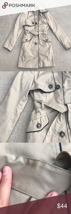 """H&M Trench Coat • 65% polyester / 35% cotton; fully lined in poly satin with light shoulder pads • Black contrast piping detail • Removable self belt; front pockets • Tiny light stains on belt and under right pocket that can barely be seen when worn (see pics); otherwise in like new condition • Length: approx 33"""" H&M Jackets & Coats Trench Coats"""