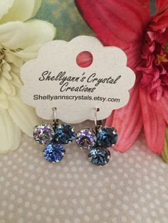 A personal favorite from my Etsy shop https://www.etsy.com/listing/462690756/swarovski-dangle-earrings