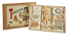 """6"""" German bisque socket-head doll by Armand Marseille, marked AM dep Germany 390, with five-piece papier-mâché flapper-style body, painted shoes and socks, in original presentation box labeled """"Trousseau."""" Doll wears her original lingerie and is presented with additional original costumes and accessories. Circa 1915."""