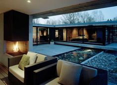 """Contemporary  U-shape, 1 bdrm.  Love the exterior window """"coverings.""""  Concerned about the slant of roof to the courtyard (drainage)..."""