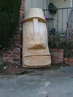 Moai tiki carved from palm wood