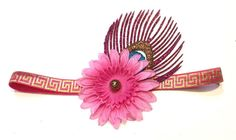 This womens Boho Chic headband features a pink silk flower with a bronze glitter center and glitter peacock feather. Headband is sized for