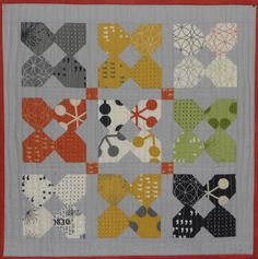A finish! Yay!    The pattern is Sherri's ( A Quilting Life ) February pattern in her Simply Small Quilt  series. I had the comma mini c...