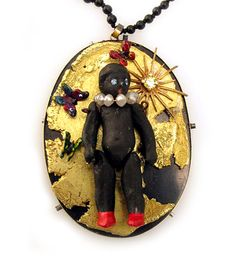 Serena Holm  Pendant: Lilla Asmodeus  Porcelain doll, gold, bull antler, silver, lacquer, part of a clockwork, diamond, sapphire, titan, onyx puss o kram