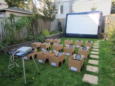 """This is so cool!  Cardboard boxes backyard drive-in movie party.  The kids decorate their """"cars"""" with stickers and markers before the movie"""