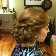 Tousled curled / braided side bun