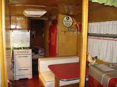 Inside of vintage trailer - kitchen by Kristi W, via Flickr
