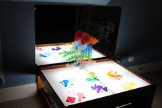 DIY Light table from Play At Home Mom LCC: She uses a train table, but like she notes you can use a coffee table or make a table. She uses lights, but I have also seen rope lights being used which is perfect right now you might be able to find some marked down from Christmas. Perfect upcycling project to save you $$