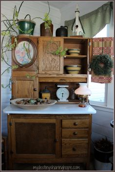 My Hoosier Cabinet. The crazy plant belonged to my husbands GREAT Aunt Jessie. Old! The kitchen scale belonged to his grandmother, but our daughter broke off part of the needle. The dough board was hers too. mydestinysharinghope.com