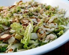 Napa Cabbage Salad With a Crunch from Food.com:   								A nice refreshing salad for the summer. I do not care for coleslaw but this salad is wonderful. It does not have the heavy mayo base. The dressing also works wonderfully on a tossed green salad or steamed veggies.