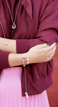 Match your pink and red outfit with pink and red hues from your PANDORA locket and PANDORA Essence bracelet.