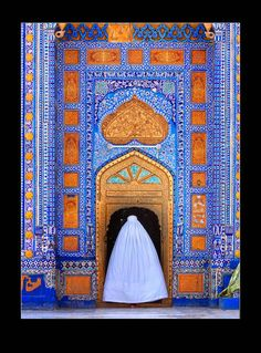 """Doors of Forgiveness"" ~ woman in traditional burqa enters tomb of Sachal Sarmast, Sufi poet, Pakistan. Photo: Umair Ghani"