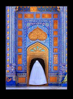 """Doors of Forgiveness"" ~ woman in traditional burqa enters tomb of Sachal Sarmast, Sufi poet, Pakistan.  Photo: Umair Ghani"
