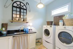 Convenient Laundry Room on the Main Floor – Madison Model, Lake Haven of Crabapple – via Edward Andrews Homes