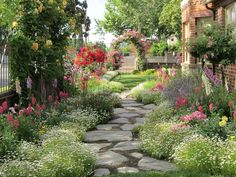 english cottage yards | side yard with rose arches