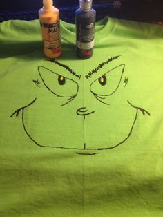 Simple Grinch face t-shirt using Tulip fabric paint