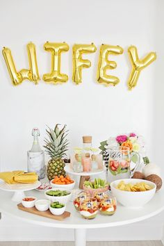 How fun would this balloon banner be for a tropical-themed bachelorette or bridal shower?