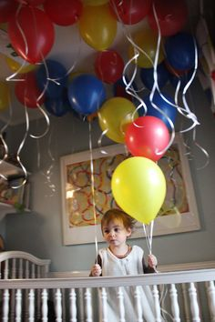 2nd birthday idea....collect helium filled balloons in two giant handfuls and entered room singing Happy Birthday.