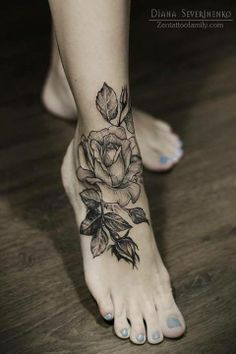 Rose foot tattoo that goes up onto ankle.