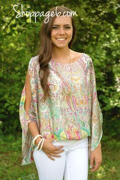 Dancing paisley print adorns this kimono style top. Gorgeous open back & tassel detail make this a sexy Summer look.     100% Polyester  Dry clean only.  Imported.