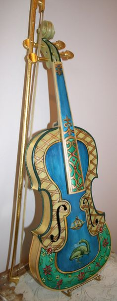 Hand pained violin by artist Marsha Bowers of Zulim Bowers Designs. Oil and gold leaf applied