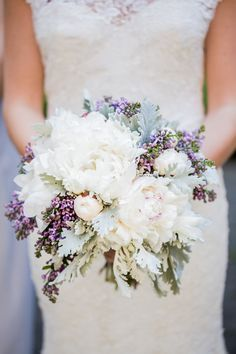 The bride will carry a bouquet of white peonies, purple waxflowers, gray dusty miller, blue succulents, ivory spray roses, and blue tweedia wrapped in ivory ribbon with the stems showing.