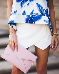 Play with lines and put on an asymmetrical mini skirt.