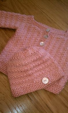 """This hat pattern is intended to coordinate with """"Demne,"""" a lovely baby cardigan pattern written and made freely available on Ravelry by Annie Cholewa (""""knitsofacto"""")."""