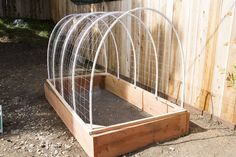 Covered Greenhouse Garden. I like the way she uses the PVC on this one. If she can bend a 10' length all the way around, we can DEFINITELY bend it to 90 degrees!