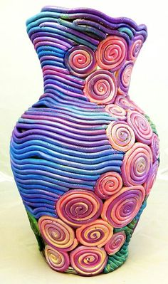 Wow...So wonderful to look at. My next pottery project! Pottery constructed using the coil method