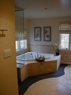 Master Suite renovation including renovation of existing bathroom area.  Materials include free-form river rock shower floor and frameless shower enclosure.