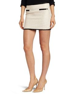 D.E.P.T. Women's Slub Lurex Boucle Skirt D.E.P.T.. $129.00. Contrast trim faux pocket. Fitted with a back zip closure. Dry Clean Only. 48% Cotton/42% Polyester/10% Lurex. Made in Turkey