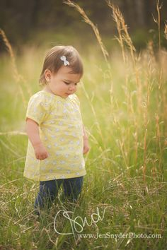 little girl in the grass, by baltimore MD child photographer jen snyder. Slow down and enjoy the little things in life! :)