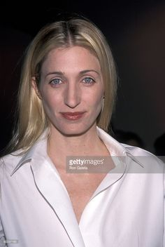 Carolyn Bessette Kennedy poses for a picture at the Annual Fundraising Gala at the Whitney Museum of American Art March 9, 1999 in New York City. Description from gettyimages.com. I searched for this on bing.com/images