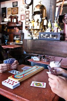 Love the idea of having small games or card games for people to play. coffee shop games