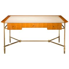 Jacques Adnet: A Brass and Ceylon Satinwood Desk | From a unique collection of antique and modern desks and writing tables at http://www.1stdibs.com/furniture/tables/desks-writing-tables/