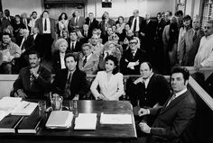 """April 3, 1998. Studio City, California -- The courtroom scene from the final days of shooting the hit show """"Seinfeld"""" including (L-R) Phil Morris, Jerry Seinfeld, Julia Louis-Dreyfus, Jason Alexander and Michael Richards. (Photo by David Hume Kennerly/Getty Images). Many series characters in the courtroom. Series Finale"""