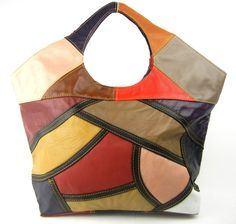Mondrian-Style Handbag. Fans of the Dutch painter Piet Mondrian will appreciate the reminiscent style of this striking, one-of-a-kind handmade leather handbag.