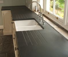 Welsh Slate Worktops Direct from our quarry. nice countertop Source by The post Welsh Slate Worktops Direct from our quarry Slate Kitchen, Barn Kitchen, Home Decor Kitchen, New Kitchen, Home Kitchens, Kitchen Design, Kitchen Ideas, Kitchen Units, Small Kitchens